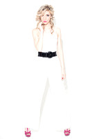 Fashion Model in White Jumpsuit on White Background