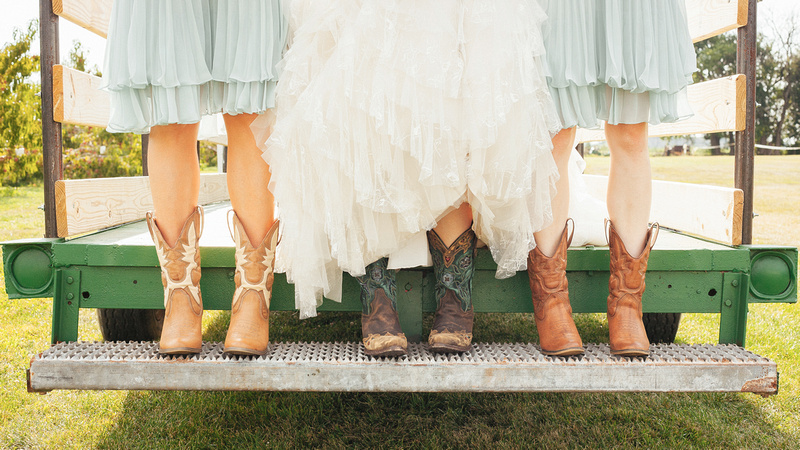 Wedding Photography of bride and brides maids with wedding dress and cowboy boots for coutry style wedding