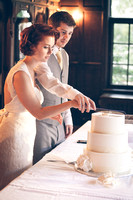 Cutting the cake - Wedding Photography by Alex Buntin in Fresno, CA